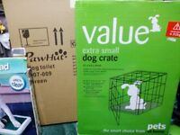 Dog crate and toilet training pads