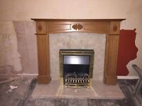 Marble fire place with wood surround and coal effect electric fire.