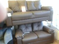 black /brown 1/2 Leather 1/2 pu . Sofa's (3 & 2 seaters)