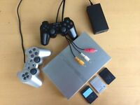 Playstation 2 - slim line, silver including two controller, 16 games & BUZZ Junior gaming set