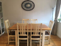 extending solid oak dining table with 6 chairs 1.26 to 1.65
