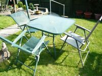 PATIO TABLE WITH GLASS TOP AND 3 CHAIRS