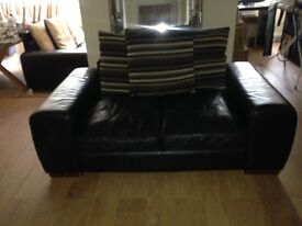 X2 brown leather sofa's