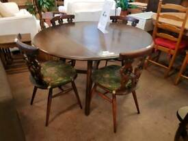 Ercol dropleaf table with cushioned seats