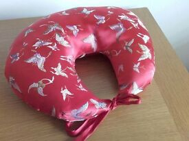 RED SATIN CUSHION FOR USE AFTER BREAST SURGERY WHEN SLEEPING