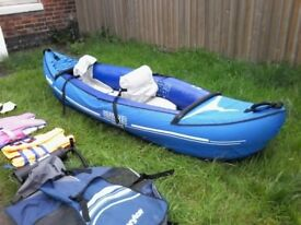 Inflatable Voyager KBC 79 profesional canoe .comes with oars and rucksack for easy transport.