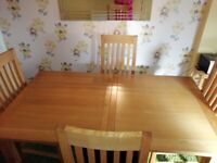 Solid oak extendable table and 4 chairs for sale