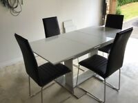 Table (extendable) and 4 chairs. Modern design.