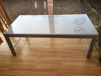 Light grey glass top coffee table