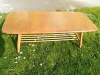 1960s ercol coffee table with magazine rack