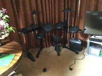Electronic drum set and amplifier Perfect for budding drummers of all ages!
