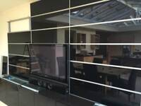 Ikea Framsta black glass and aluminium wall covering