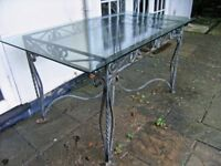 Large glass and metal dining table