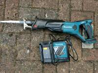 Makita reciprocating saw and charger