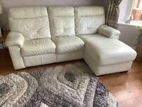 Cream leather electric recliner suite.