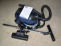 VAX bagless vacuum cleaner with all attachments and instructions