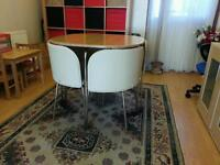Ikea dinning table with 4 cream leather effect chairs. Excellent condition