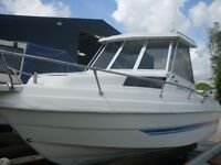 Drago Sunday Fisher Pilothouse with 2005 Evinrude 75 HP Etec Outboard Engine Trim Tabs and Trailer