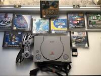 PlayStation 1 + 9 games + controller + memory card