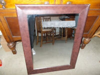 Leather framed over-mantel mirror