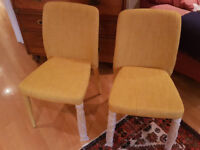 Two modern chairs still wrapped yellow upholstery (including legs) change of colour scheme