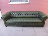 A Large Green Leather Chesterfield Buttoned Sofa