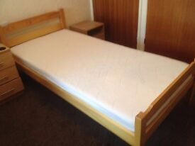 single wooden bed and memory foam mattress .