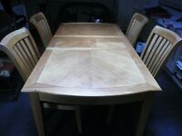 solid wood extending dining room table and 4 chairs