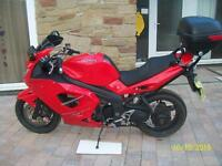 Triumph Sprint ST 1050 2007 in Tornado Red with Givi Monokey Rack included.