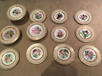 9 Antique Dinner plates and 3 antique cake plate stands