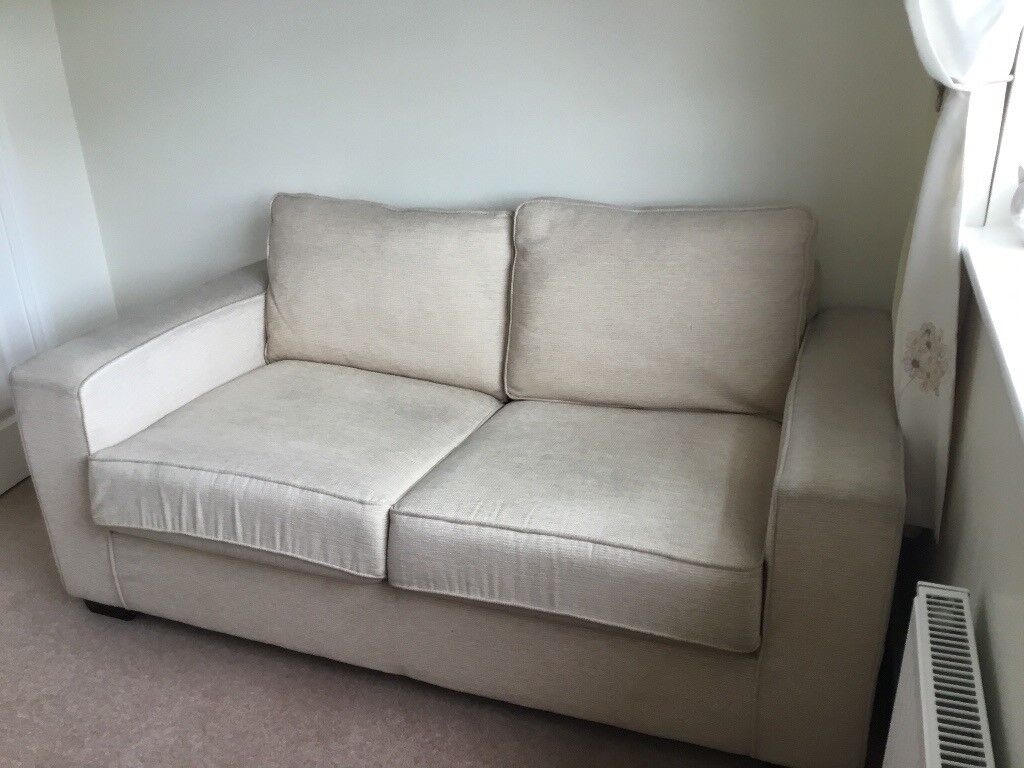 Two seater cream sofa bed. Manufacturer Som'Toile. In addition cream bean-bag Reduced price to sell