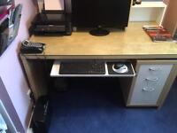 Ikea computer desk with glass top. Comes with matching shelves and drawers.