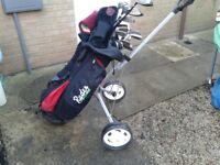 Golf clubs golf bag and trolley