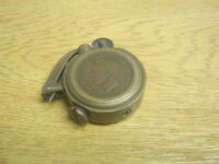 A WWII Trench Art British half pence copper lighter
