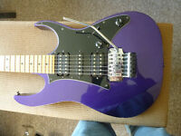 Ibanez RG Series with floating tremelo bridge in stunning metallic purple