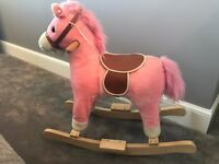 Pink rocking horse with sounds.