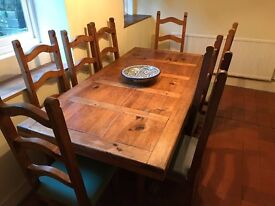 Dining table and eight chairs. Beautiful and rustic table that looks fabulous.
