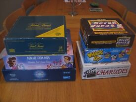 Selection of board games including Trivial pursuit, who wants to be a millionaire, Charudes & more
