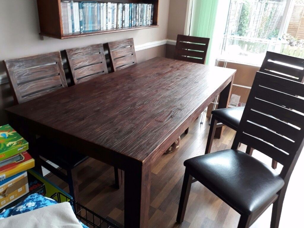 Solid wooden dark dining table and 6 chairs for sale.
