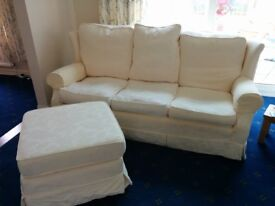 3 seater sofa and matching footstool.