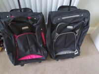 Two Carry On Suitcases