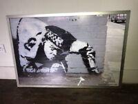 Banksy photograph framed policeman