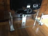 Rectangular glass and silver TV stand or coffee table