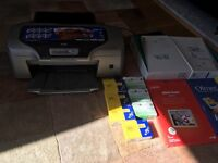 Epson stylus photo R800 printer for sale. Also includes 7 ink cartridges and photo paper