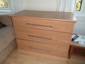 Two sets of three drawers