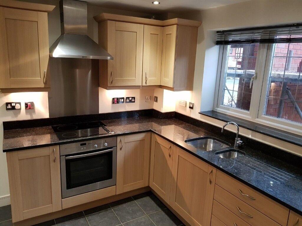 Oak Kitchen With Neff Appliances And Black Granite