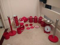 Red kitchen storage jars etc