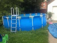 18 ft. pool ! with filter, ladder and solar cover !
