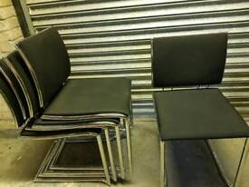 Five crome and black chairs