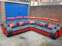 Stunning large leather corner sofa.different colours.black/red.modern design. Brand New. can deliver